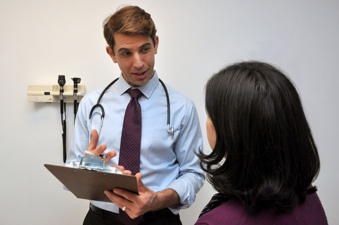 A doctor talks to a patient.
